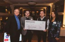 Team members at Case Western Reserve University startup competition pose with an oversized check