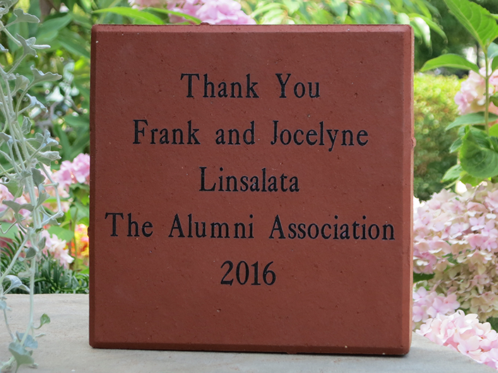 "Photo of engraved paver stone which says, ""Thank You Frank and Jocelyne Linsalata The Alumni Association 2016"""