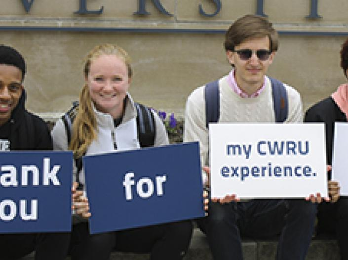 image of students holding thank you signs