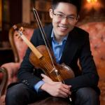 Portrait of Alan Choo holding his violin