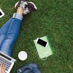 Image of school supplies in the grass
