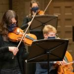 String players performing masked at the Maltz Performing Arts Center