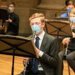 Woodwind students perform masked in the Maltz Performing Arts Center