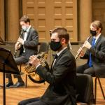 Symphonic Wind musicians play masked at the Maltz Performing Arts Center