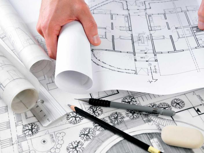 Person reviewing architectural designs