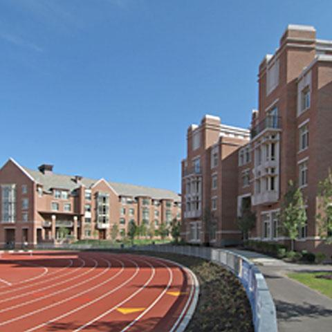 Exterior of dorms with the running track in front
