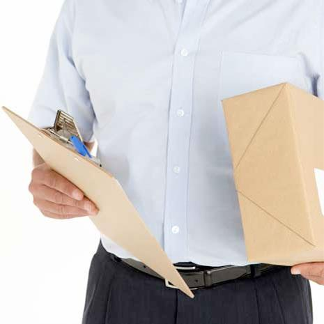 someone holding a box and envelope