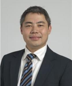 Portrait of Samuel Chao wearing dark suit, white shirt and tie.