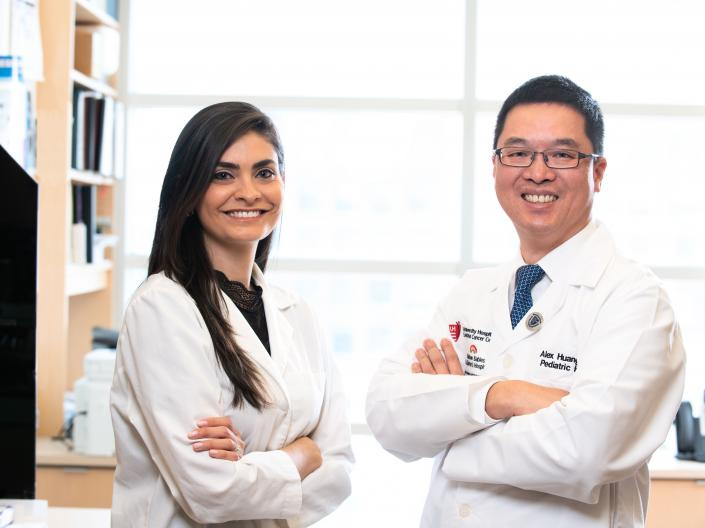 Yami Huerta and Alex Huang standing in lab