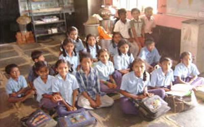 Young children sit inside their school room in Bangalore India