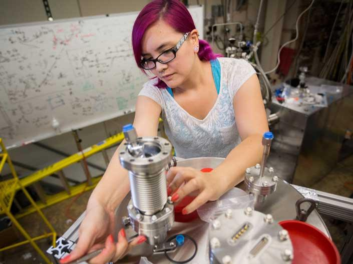 Case Western Reserve University female engineering student working in a lab