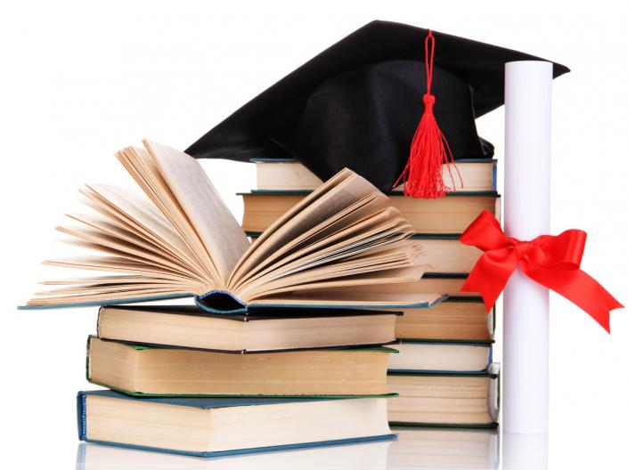 Graduate cap and diploma with books
