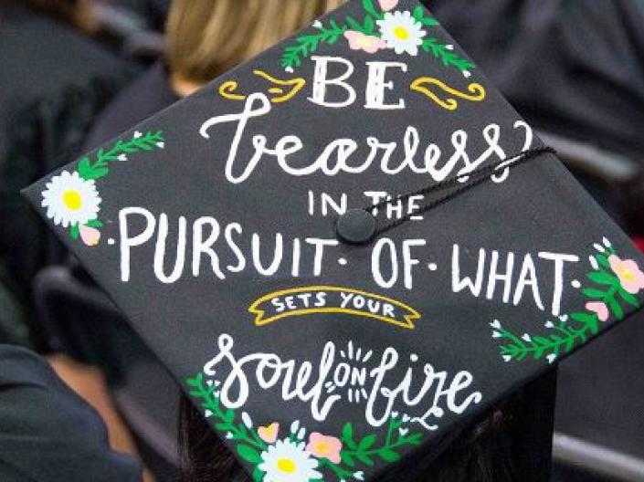 "Photo of a graduation cap, painted with the words ""Be fearless in the pursuit of what sets your soul on fire."""