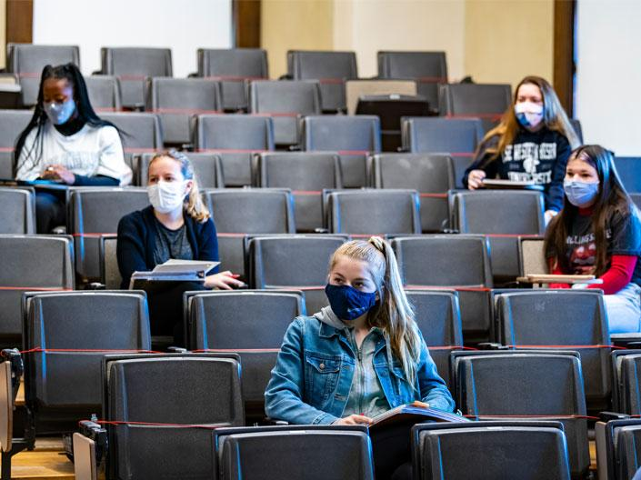 A classroom at Case Western Reserve University with students wearing masks spaced at a safe distance