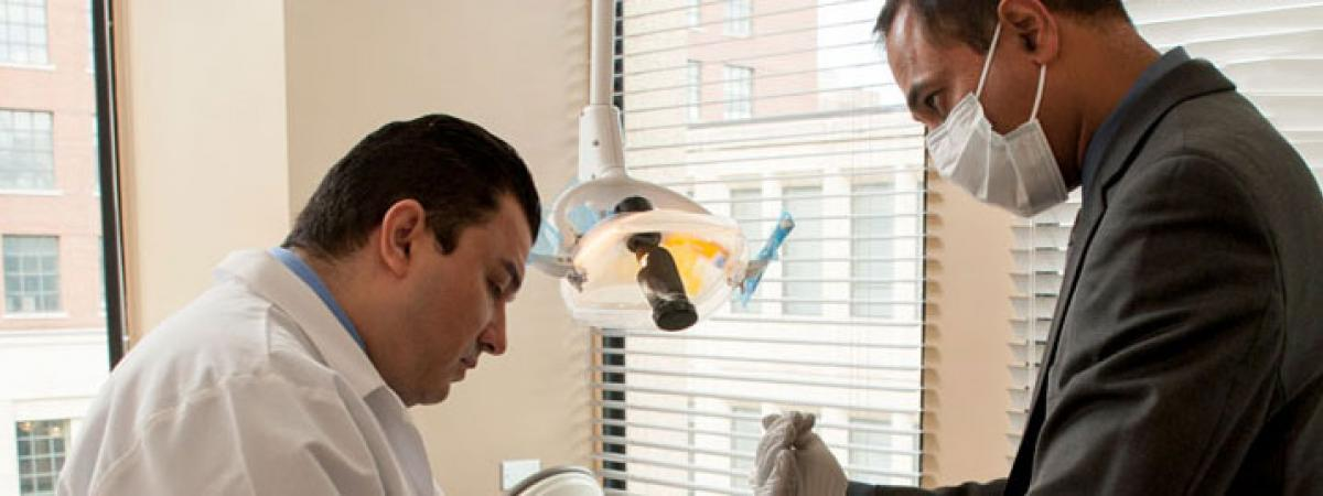 Two dentists examining a patient.