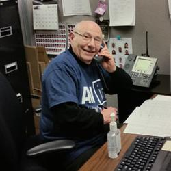 An alumni member answering the phones