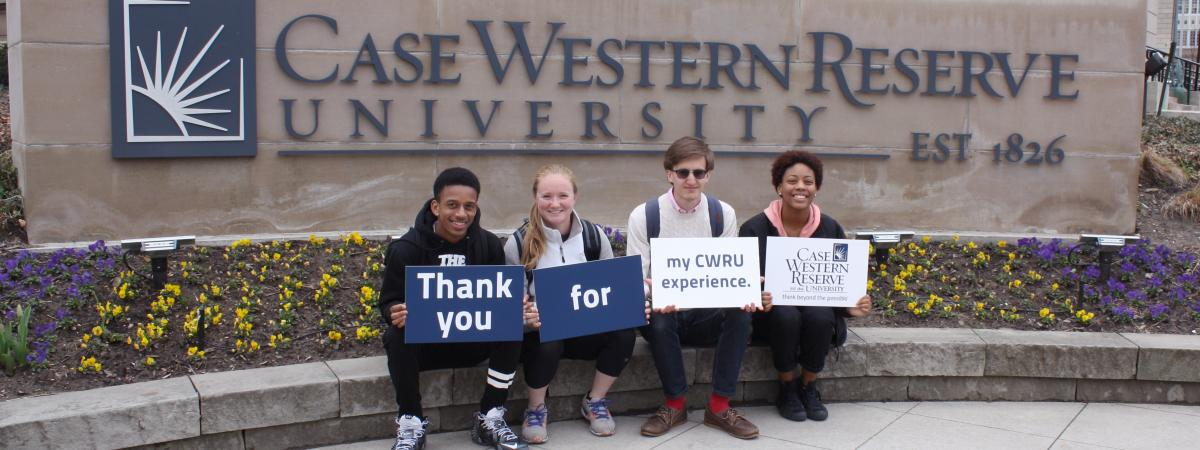 image of students in front of Case Western holding thank you signs