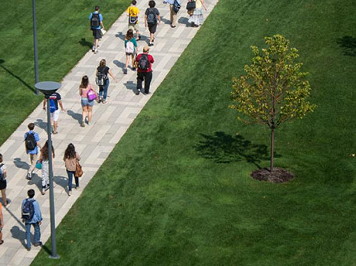 Image of students walking across campus