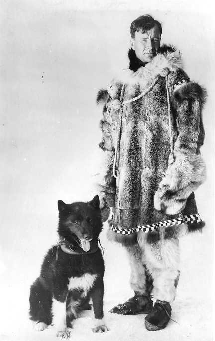 The sled dog Balto, named for explorer Samuel Johansen Balto, stands beside his owner, Gunnar Kasson, ca. 1925. CPL