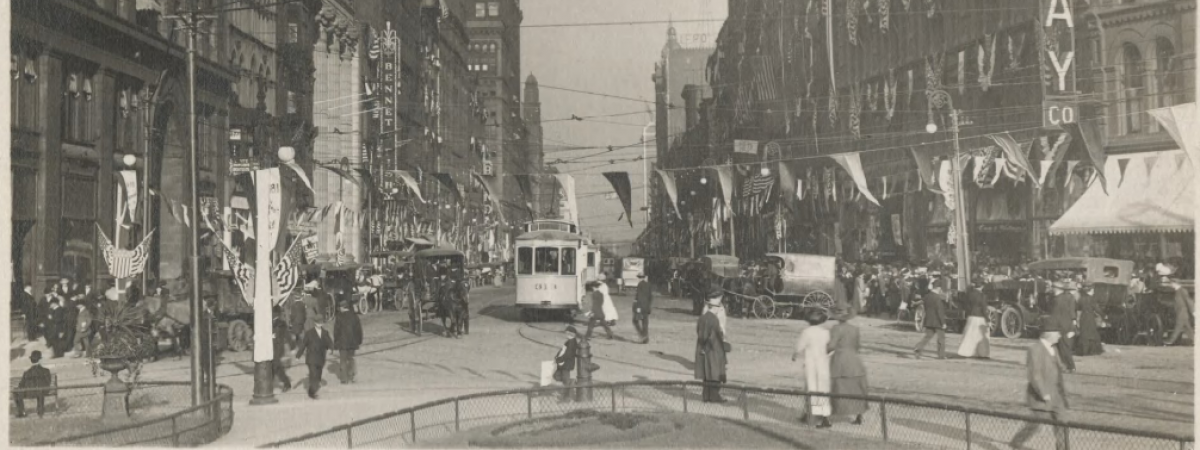 Looking east from S.E. corner of square;centennial celebration. Filled with horse and carriages, trolley cars and automobiles