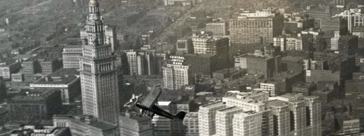 Aerial view of Union Terminal Development and a flying plane in the foreground