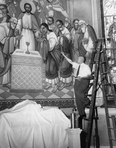 Russian émigré artist Andrei Bicenko puts the finishing touches on the altar fresco at St. Theodosius, 1954.