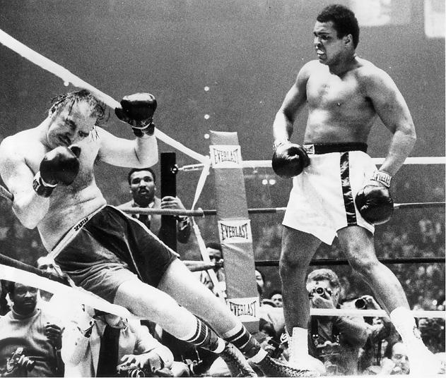 From the Cleveland Press Collection at the CSU Archives, an image of Muhammad Ali watching Chuck Wepner fall to the canvas in the 15th round, 24 Mar. 1975.