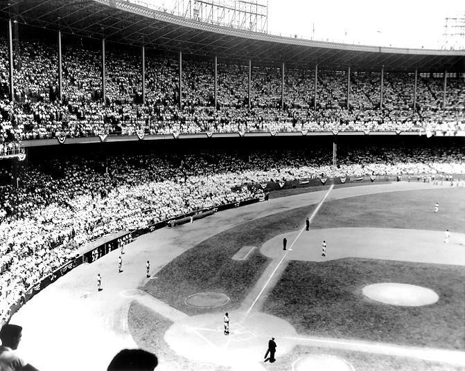 The crowd and players stand for the National Anthem at the 1954 All Star Game held at Cleveland