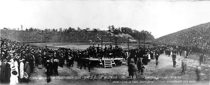 "A view from behind home plate shows a crowd of over 100,000 watching the intercity championship baseball game between White Auto and Omaha ""Luxus"" teams at Brookside Park Stadium, 10 Oct. 1915.  WRHS"