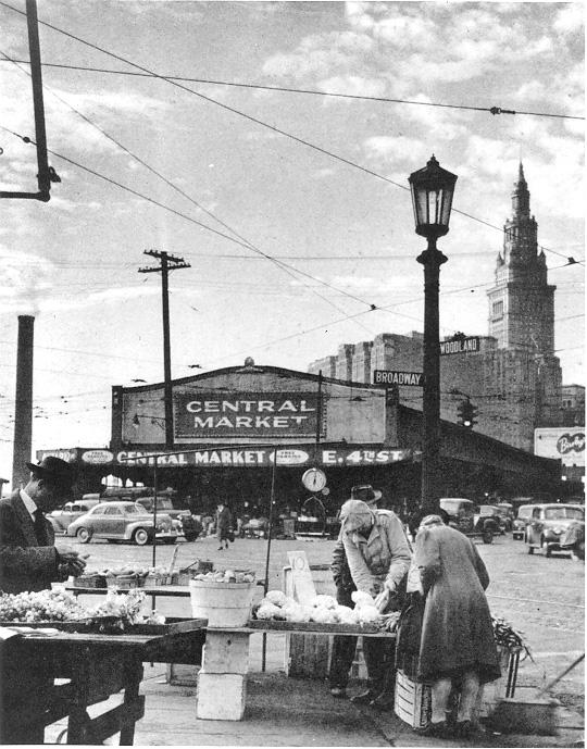 Shoppers look for bargains at dealers' tables outside the Central Market, E. 4th St., ca. 1946. WRHS