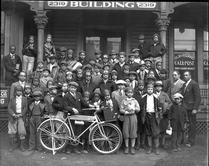 African-American newsboys gather in front of the Call & Post building, home to Cleveland