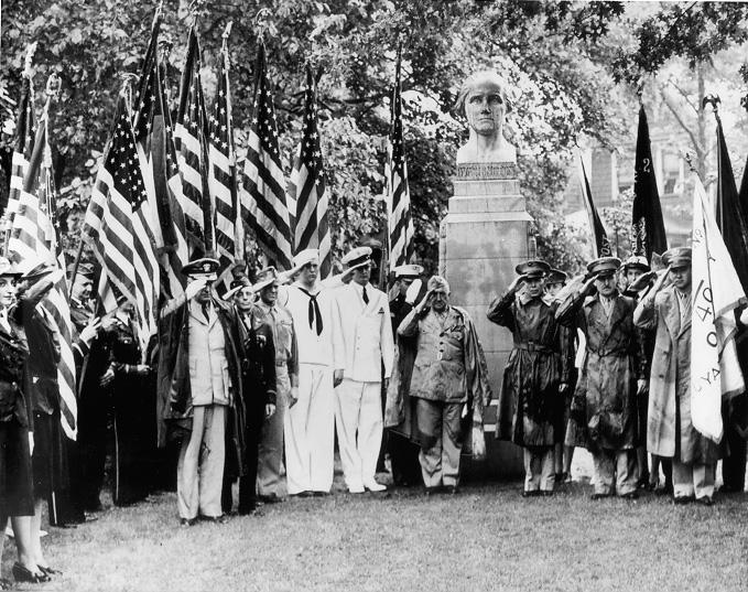 Armed forces personnel bearing flags stand at attention at the dedication ceremonies of the American Cultural Garden, July 1943. Courtesy of the Plain Dealer
