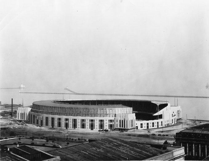 Cleveland Municipal Stadium shortly after its completion with Lake Erie in the background.