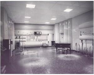 A piano and microphones stand in the main studio of the Cleveland Recording Co in this undated photograph