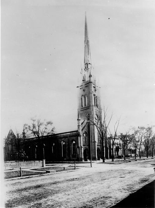 The tall spire of the Euclid Ave. Baptist Church dwarfs other buildings along Euclid near East 18th Street, ca. 1900. WRHS
