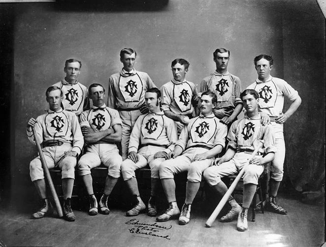 Members of the Forest City Baseball Club pose for a formal studio photograph in uniform and with bats in the early 1880s. WRHS.