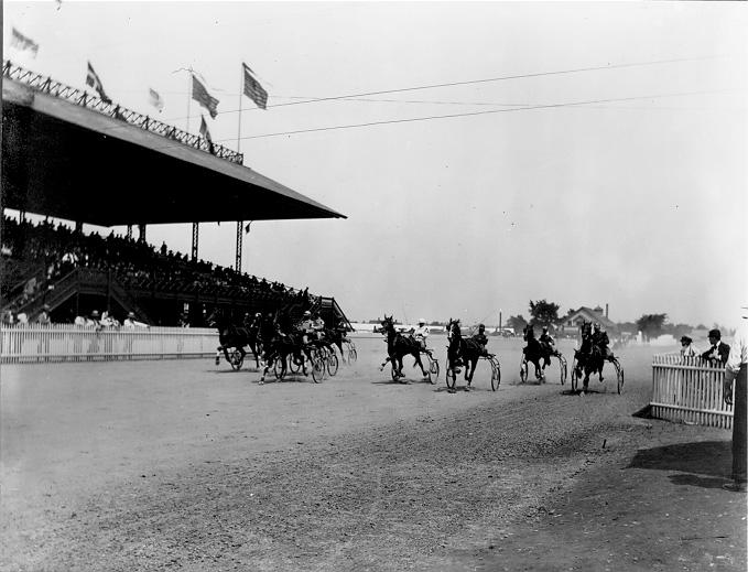 A full grandstand of spectators watch harness racing at Glenville Track, ca. 1900. WRHS.