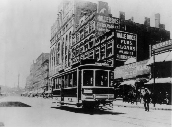 A streetcar stops in front of the early Euclid Ave. location of Halle Bros. Department Store, ca. 1900. WRHS.