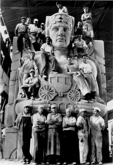 Stone carvers pose in their workshop on a sculptural pylon for the Lorain-Carnegie Bridge, later renamed the Hope Memorial Bridge, ca. 1931. WRHS.