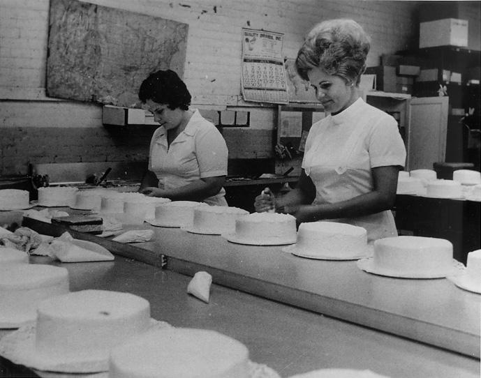 Bakers hand-decorate cakes at the main plant of Hough Bakery, 1973. CPL.