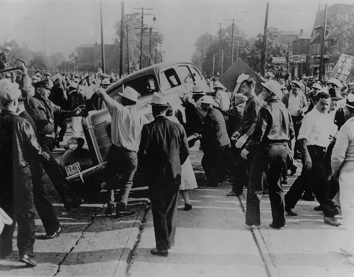 Violence erupts as strikers overturn a vehicle outside the Fisher Body Plant, 1939. Cleveland Press Collection, CSU Archives/Photo by Fred Bottomer.