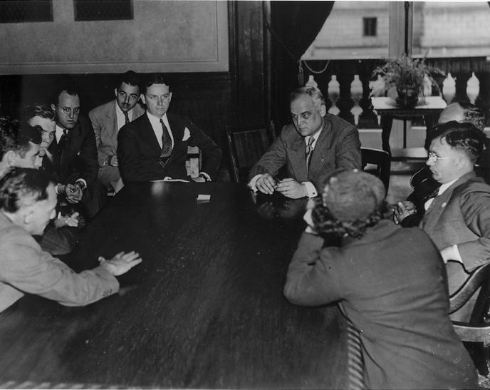 Mayor Harold Burton and Safety Director Eliot Ness meet with the Steel Workers