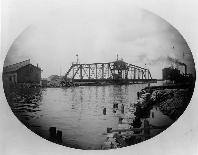 An early predecessor of the Main Ave. (Harold H. Burton Memorial) Bridge was this 200-foot hand-operated swing bridge, completed in 1869. WRHS.