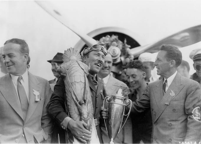 Fred Crawford (right) presents the Thompson Trophy to Roscoe Turner at the National Air Races. WRHS.