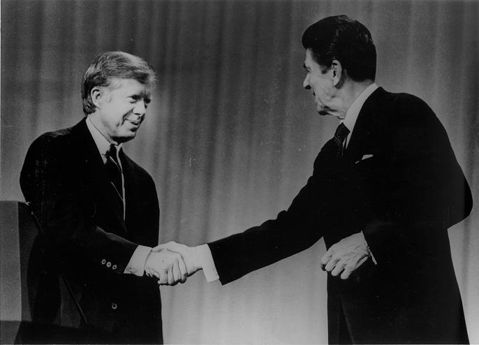 Pres. Jimmy Carter and Republican candidate Ronald Reagan shake hands at the conclusion of the Presidential Debate, 28 Oct. 1980. Cleveland Press Collection, CSU Archives.