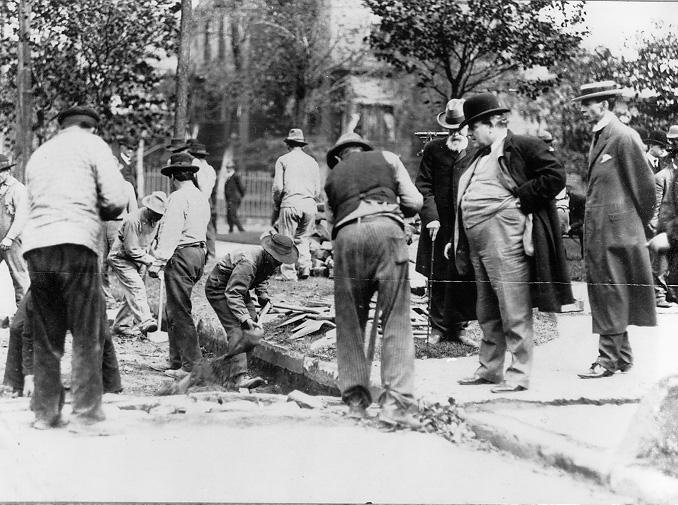 Cleveland Mayor Tom L. Johnson inspects a city street repair crew and its work, ca. 1907. WRHS.