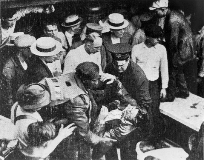 Garrett Morgan rescues a victim of the Waterworks Tunnel Disaster, July 1916. WRHS.