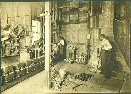 George G. Jones with assistant at Favorite Brass Foundry, 2539 Central Ave.