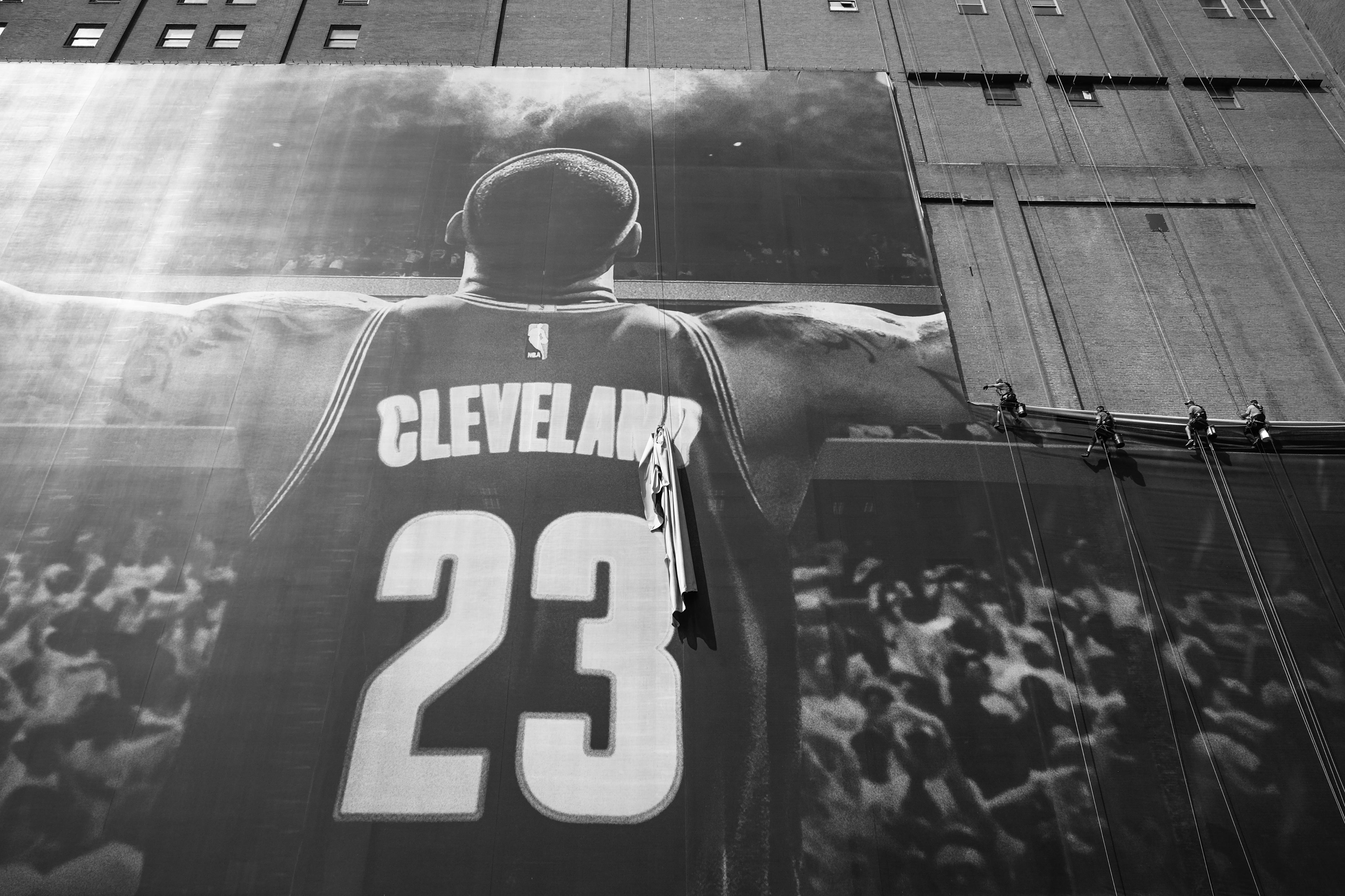 LeBron James banner being taken down from the Sherwin Williams building July 3, 2018
