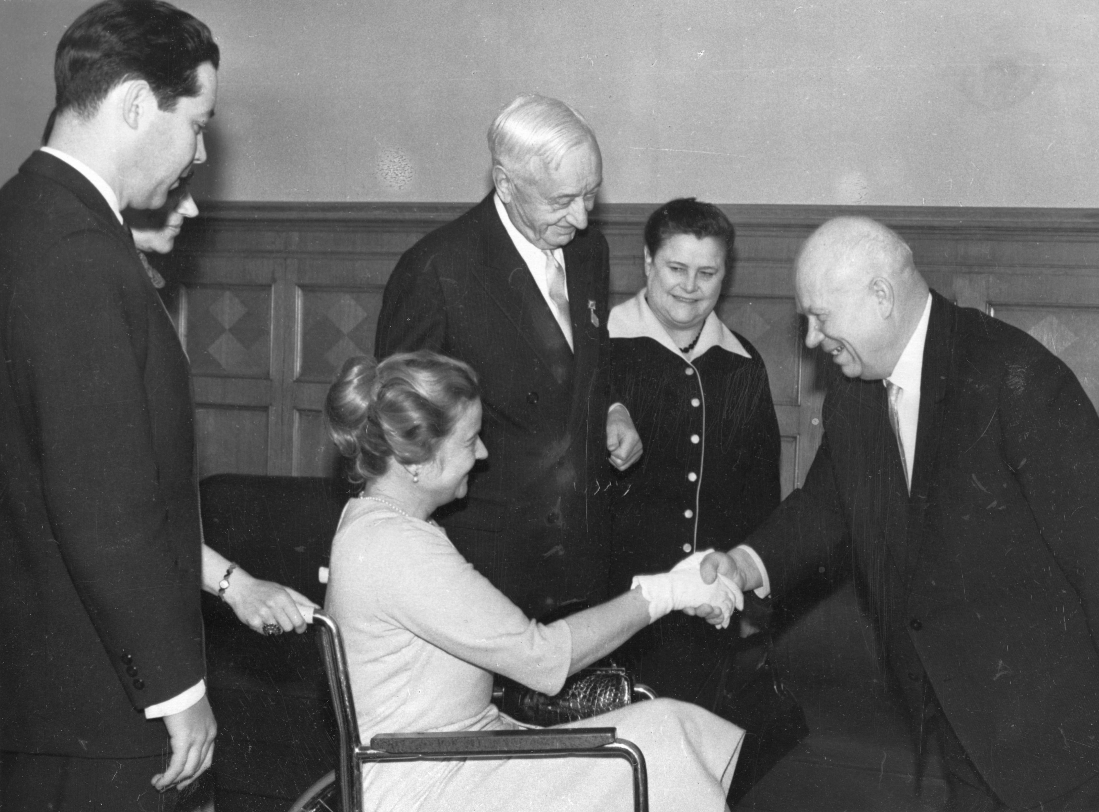 Cyrus Eaton (standing) and his wife Anne (seated in a wheelchair) meet with Nikita Khrushchev in Moscow, 1964.